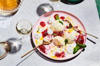 """Store-bought meringue cookies and frozen berries make this elegant sundae come together in a snap. Basil leaves add a fresh finish. <a href=""""https://www.epicurious.com/recipes/food/views/meringue-sundae-with-peppery-berry-sauce?mbid=synd_yahoo_rss"""" rel=""""nofollow noopener"""" target=""""_blank"""" data-ylk=""""slk:See recipe."""" class=""""link rapid-noclick-resp"""">See recipe.</a>"""
