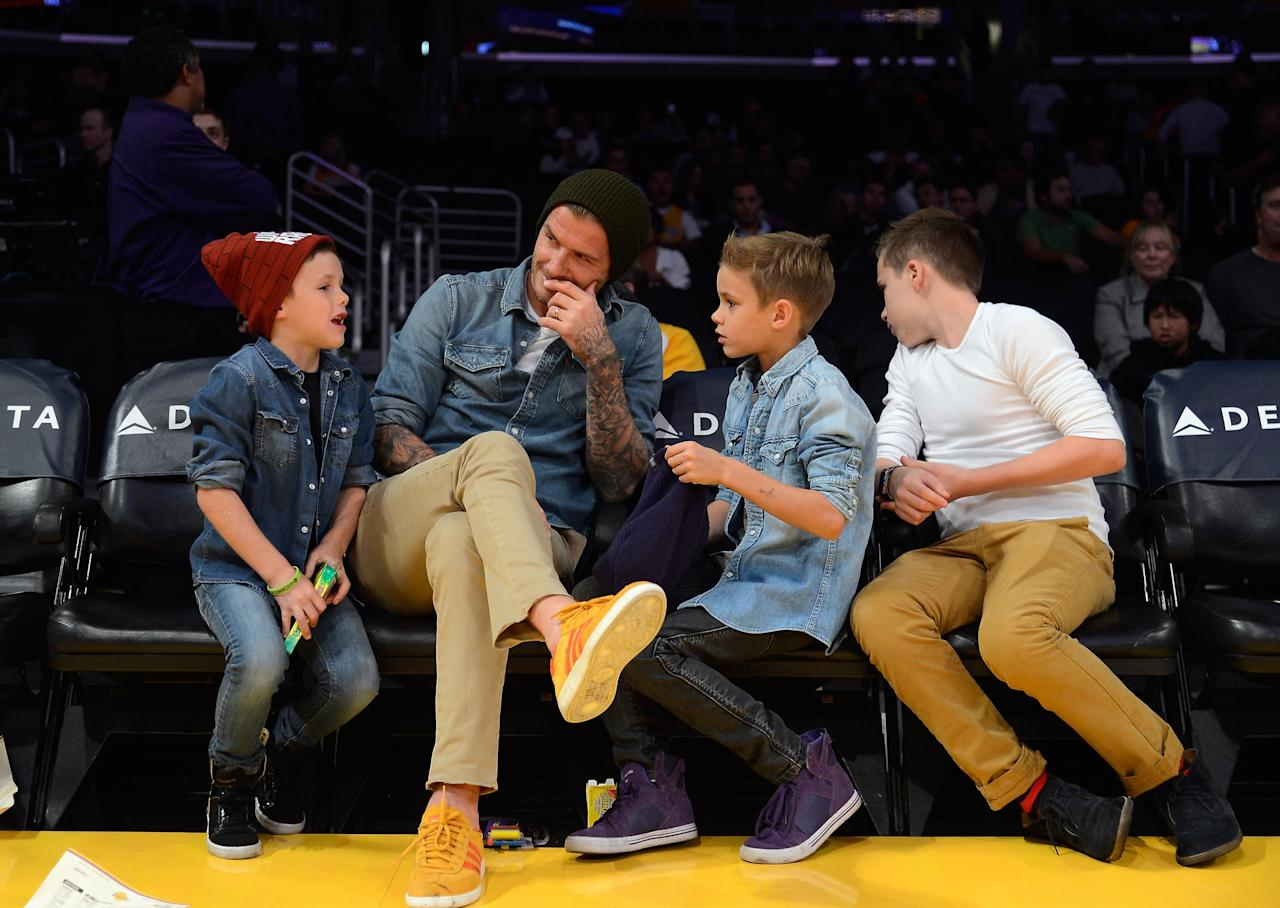 LOS ANGELES, CA - NOVEMBER 16:  David Beckham and his sons  Cruz Beckham (L)  Romeo Beckham and Brooklyn Beckham (R) attend the Los Angeles Lakers and  Phoenix Suns NBA basketball game at Staples Center on November 16, 2012 in Los Angeles, California. NOTE TO USER: User expressly acknowledges and agrees that, by downloading and or using this photograph, User is consenting to the terms and conditions of the Getty Images License Agreement.  (Photo by Kevork Djansezian/Getty Images)