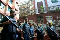 Police cordoned off a five-storey apartment building in Dhaka after suspects threw a small bomb at officers