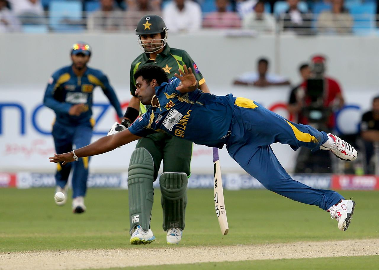 DUBAI, UNITED ARAB EMIRATES - DECEMBER 20:  Thisara Perera of Sri Lanka in action during the second One-Day International (ODI ) match between Sri Lanka and Pakistan at the Dubai Sports City Cricket Stadium on December 20, 2013 in Dubai, United Arab Emirates.  (Photo by Francois Nel/Getty Images)