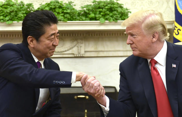 President Donald Trump shakes hands with Japanese Prime Minister Shinzo Abe in the Oval Office of the White House in Washington, Thursday, June 7, 2018. (AP Photo/Susan Walsh)