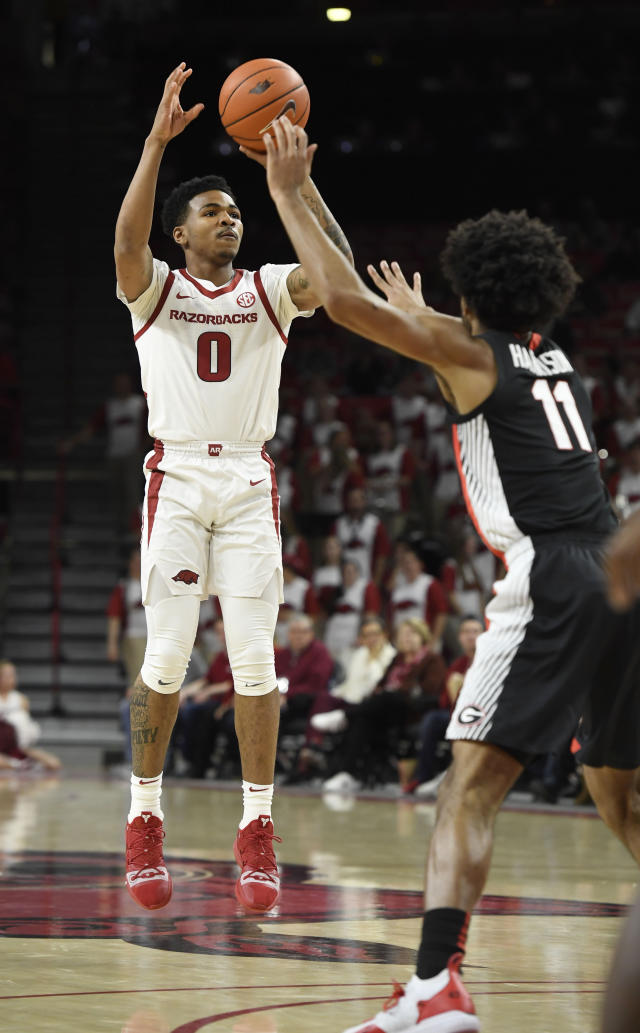 Arkansas guard Desi Sills (0) drives past Georgia defender Christian Harrison (11) during the first half of an NCAA college basketball game, Tuesday, Jan.29, 2019 in Fayetteville, Ark. (AP Photo/Michael Woods)
