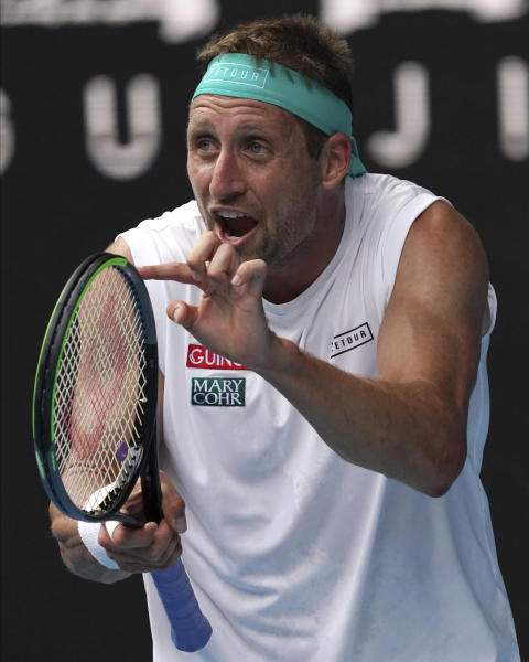 Tennys Sandgren of the U.S. reacts after losing a point to Switzerland's Roger Federer during their quarterfinal match at the Australian Open tennis championship in Melbourne, Australia, Tuesday, Jan. 28, 2020. (AP Photo/Lee Jin-man)