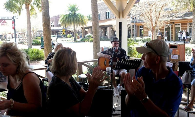 A musician plays to a crowd at Brownwood Paddock Square in The Villages in March.