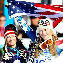 Julia Mancuso (L) celebrates winning silver and Lindsey Vonn of the United States gold during the flower ceremony