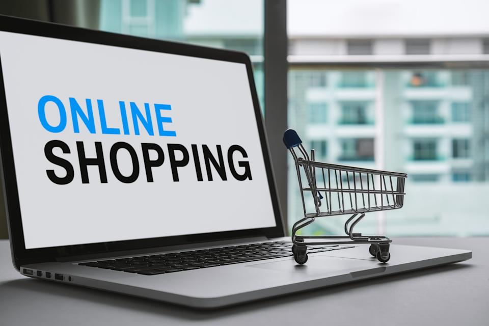 Shopping Cart and Laptop. Online Shopping Concept.
