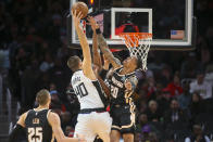Los Angeles Clippers center Ivica Zubac (40) is defended by Atlanta Hawks forward John Collins (20) in the first half of an NBA basketball game Wednesday, Jan. 22, 2020, in Atlanta, Ga. (AP Photo/Brett Davis)