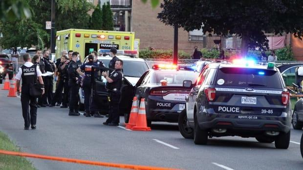 Police say it appears all 5 victims were in the same apartment when they were hit by gunfire Monday. (Mathieu Wagner/Radio-Canada - image credit)