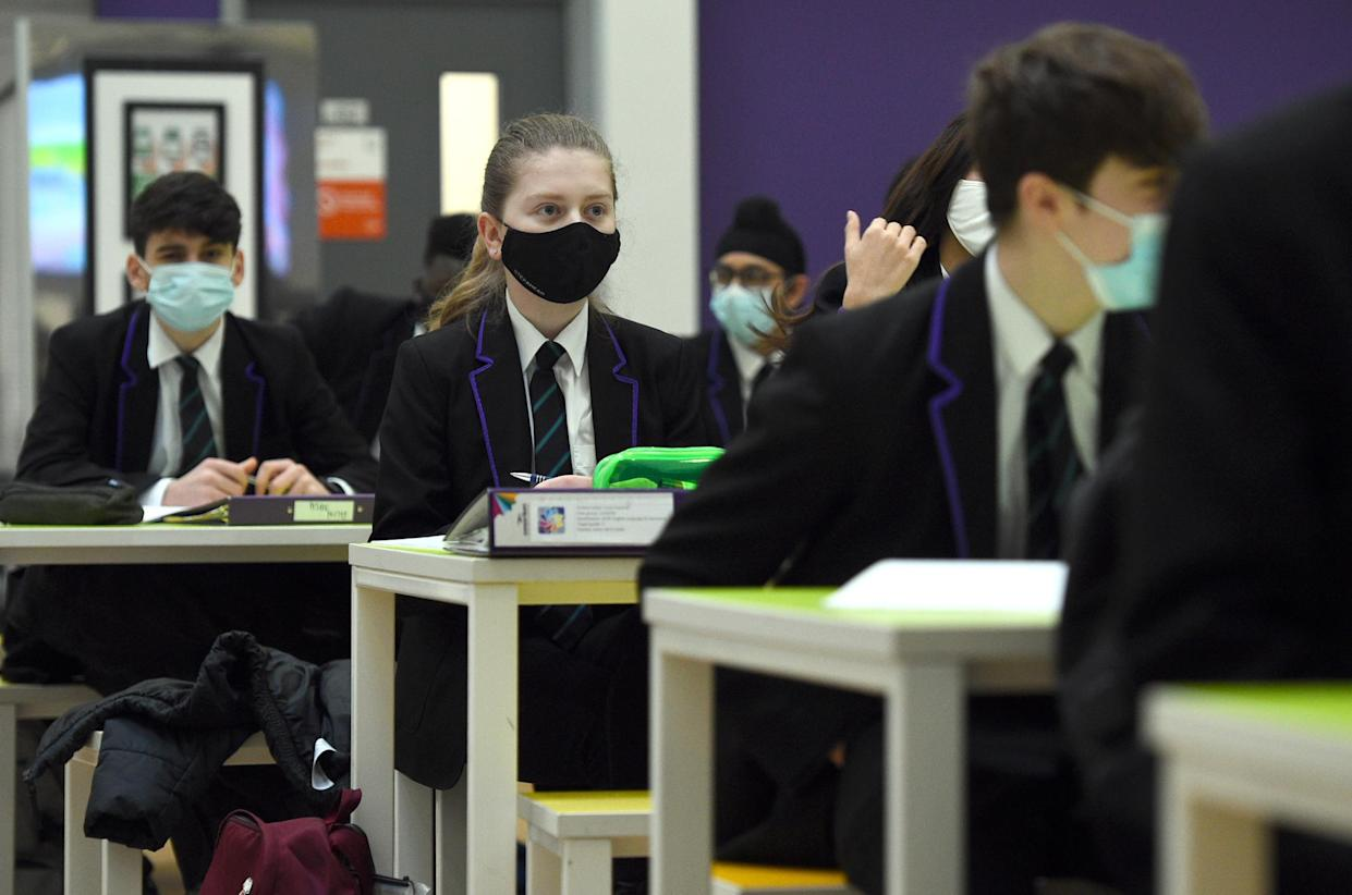 Children wearing facemasks during a lesson at Hounslow Kingsley Academy in West London, as pupils in England return to school for the first time in two months as part of the first stage of lockdown easing. Picture date: Monday March 8, 2021.