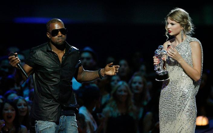 The feud between the couple and Taylor Swift (r) can be traced back to a 2009 incident - Jason DeCrow
