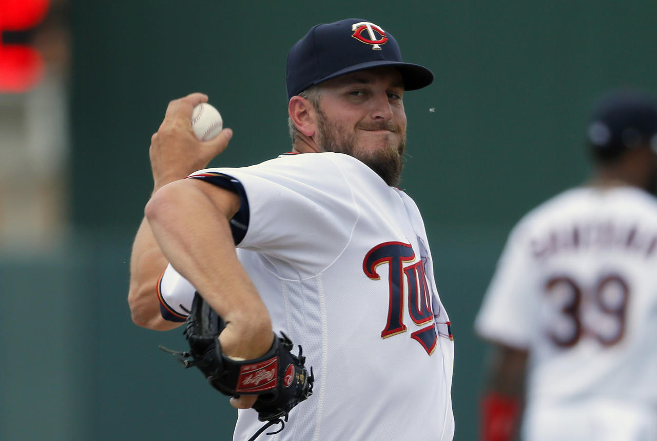 FILE - In this March 23, 2016, file photo, Minnesota Twins' Glen Perkins throws a warm up pitch in the seventh inning of a spring training baseball game against the Tampa Bay Rays, in Fort Myers, Fla. The Minnesota Twins have reinstated relief pitcher Glen Perkins from the disabled list, where he's been for more than 16 months because of shoulder trouble. The Twins made the move Thursday, Aug. 17, 2017, before their doubleheader against Cleveland, with all arms needed on deck against the division leaders. (AP Photo/Tony Gutierrez, File)