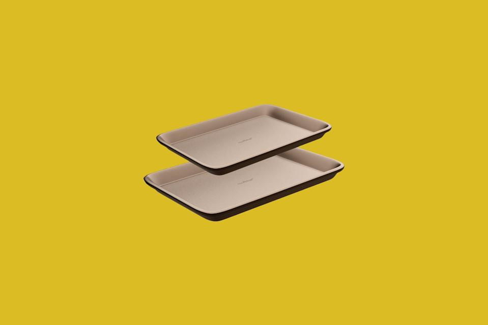 """<p>This set of medium and large baking sheets is made from durable carbon steel and boasts a nonstick coating, meaning your food will brown beautifully and cleanup will be a breeze. The heat retention capabilities of the carbon steel make it a particularly good for deeply caramelized roasted vegetables like this <a href=""""https://www.marthastewart.com/1112924/cauliflower-steaks-romesco-sauce%3e"""" rel=""""nofollow noopener"""" target=""""_blank"""" data-ylk=""""slk:cauliflower dish"""" class=""""link rapid-noclick-resp"""">cauliflower dish</a>.</p> <p><strong><em>Shop Now:</em></strong><em> NutriChef NC2TRBK1 Non-Stick Pan Set, $21.99, <a href=""""http://goto.walmart.com/c/249354/565706/9383?subId1=MSLOurShoppableGuidetoSheetPansandCookieSheetsvspence2FooGal7847984202007I&u=https%3A%2F%2Fwww.walmart.com%2Fip%2FNutriChef-NC2TRBK1-Non-Stick-Pan-Set%2F547892435"""" rel=""""nofollow noopener"""" target=""""_blank"""" data-ylk=""""slk:walmart.com"""" class=""""link rapid-noclick-resp"""">walmart.com</a>.</em></p>"""