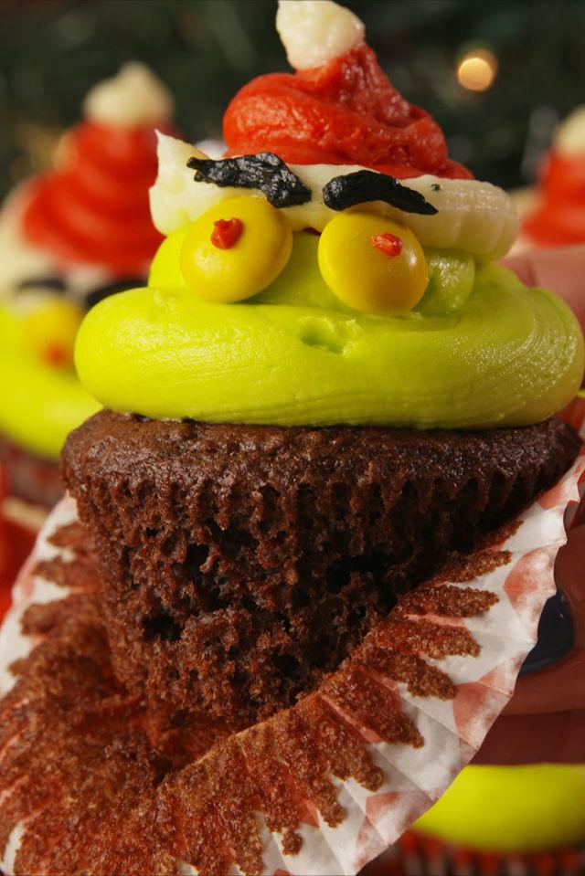 """<p>Even the Grinch would have to admit these are cute.</p><p>Get the recipe from <a rel=""""nofollow"""" href=""""http://www.delish.com/cooking/recipe-ideas/recipes/a57056/kranky-cupcakes-recipe/"""">Delish</a>.</p><p><strong><em>BUY NOW: Cupcake Pan, $7.20, <a rel=""""nofollow"""" href=""""https://www.amazon.com/Wilton-Recipe-Nonstick-12-Cup-Regular/dp/B003W0UMPI/ref=sr_1_1?tag=syndication-20&s=home-garden&ie=UTF8&qid=1512520421&sr=1-1&keywords=cupcake+tin&&ascsubtag=[artid"""">amazon.com</a>.</em></strong></p>"""