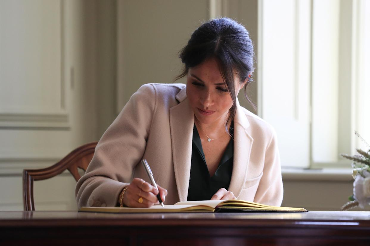 Meghan, Duchess of Sussex signs the visitors book during an engagement at Edes House, in Chichester, Britain October 3, 2018. Daniel Leal-Olivas/pool via Reuters