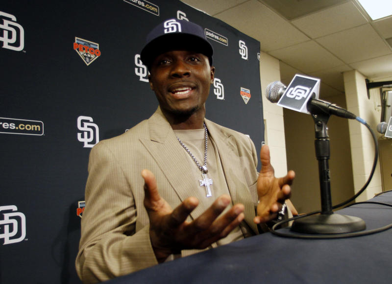 Former Minnesota Twins second baseman Orlando Hudson sports his new hat as he talks about becoming a  San Diego Padre at a news conference in San Diego, Monday, Dec. 20, 2010. Hudson signed a $11.5 million, two year  contract. (AP Photo/Lenny Ignelzi)