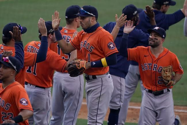Correa, Springer rally Astros past A's 10-5 in ALDS opener