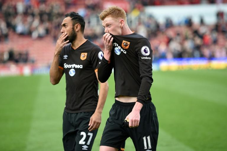 Hull City's Ahmed Elmohamady (L) and Sam Clucas react to their defeat on the pitch after their match against Stoke at the Bet365 Stadium in Stoke-on-Trent, central England on April 15, 2017