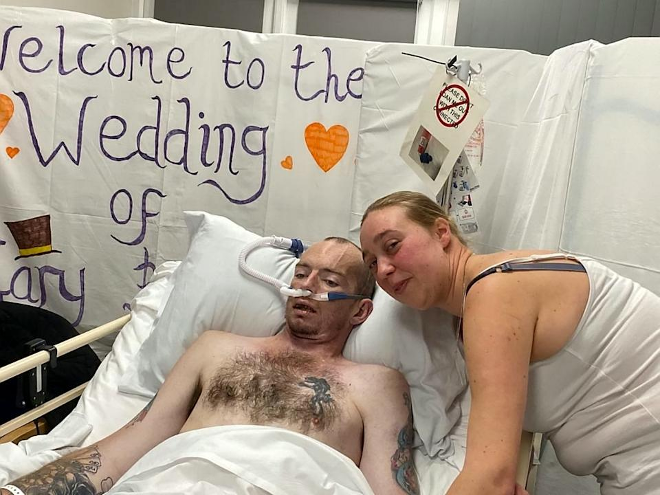 Laura Smart helps her dying husband fulfill his last wish as she marries him on his deathbed. [Photo: SWNS]