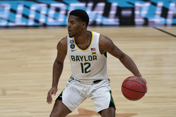 Baylor guard Jared Butler drives up court during the first half of a men's Final Four NCAA college basketball tournament semifinal game against Houston, Saturday, April 3, 2021, at Lucas Oil Stadium in Indianapolis. (AP Photo/Michael Conroy)