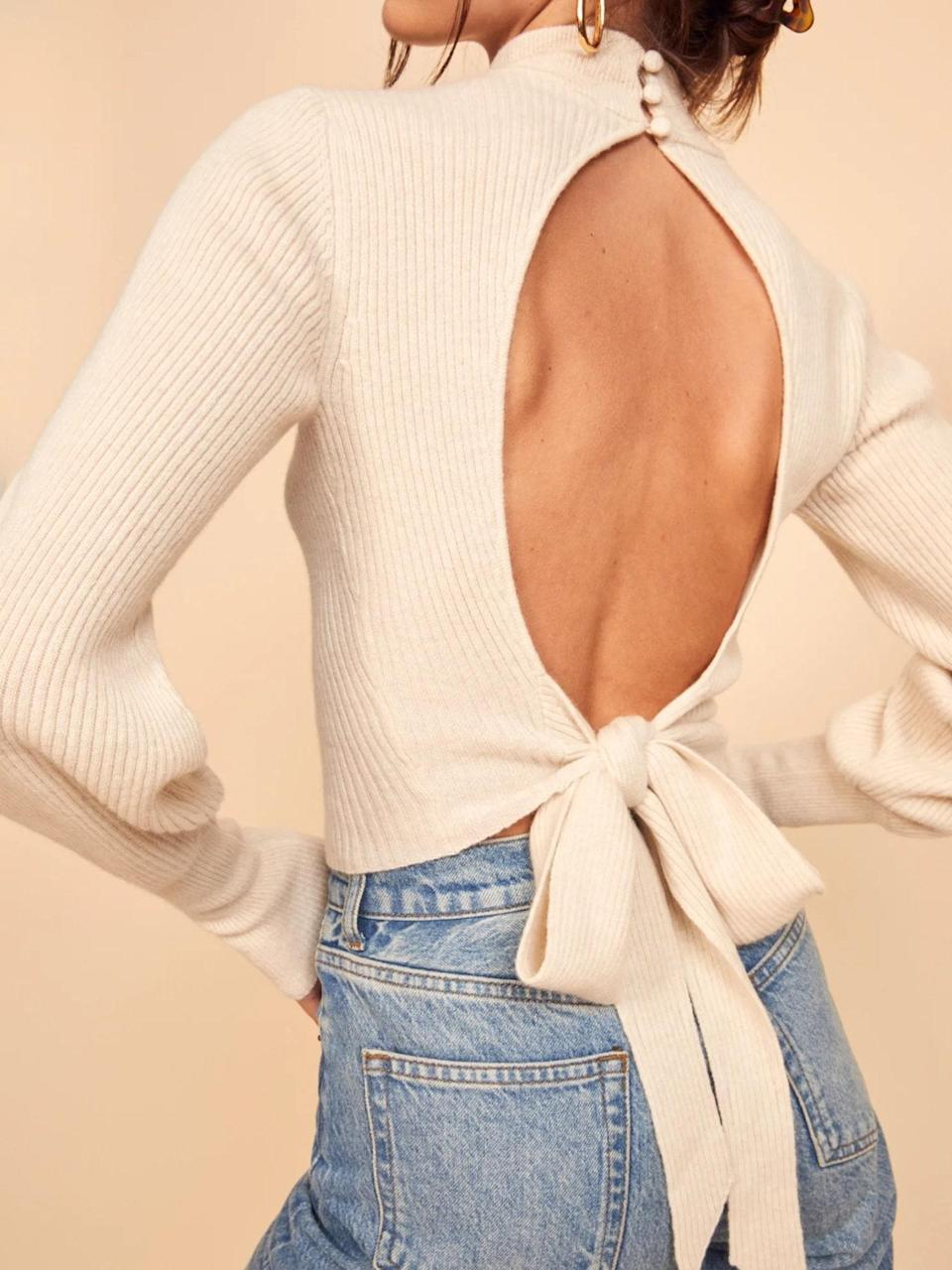 """With a mock neck and open back, this is the kind of sexy but low-key knit you can wear on so many date nights. $228, Reformation. <a href=""""https://www.thereformation.com/products/osteria-sweater"""" rel=""""nofollow noopener"""" target=""""_blank"""" data-ylk=""""slk:Get it now!"""" class=""""link rapid-noclick-resp"""">Get it now!</a>"""
