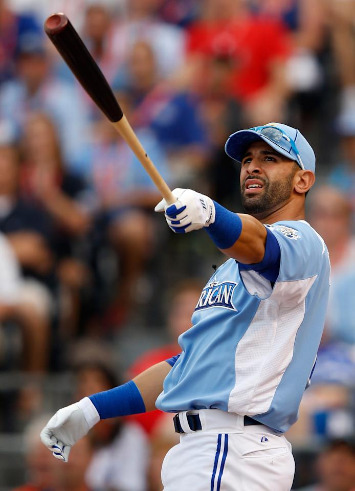 KANSAS CITY, MO - JULY 09:  American League All-Star Jose Bautista #19 of the Toronto Blue Jays reacts as he is at bat in the first round during the State Farm Home Run Derby at Kauffman Stadium on July 9, 2012 in Kansas City, Missouri.  (Photo by Jamie Squire/Getty Images)