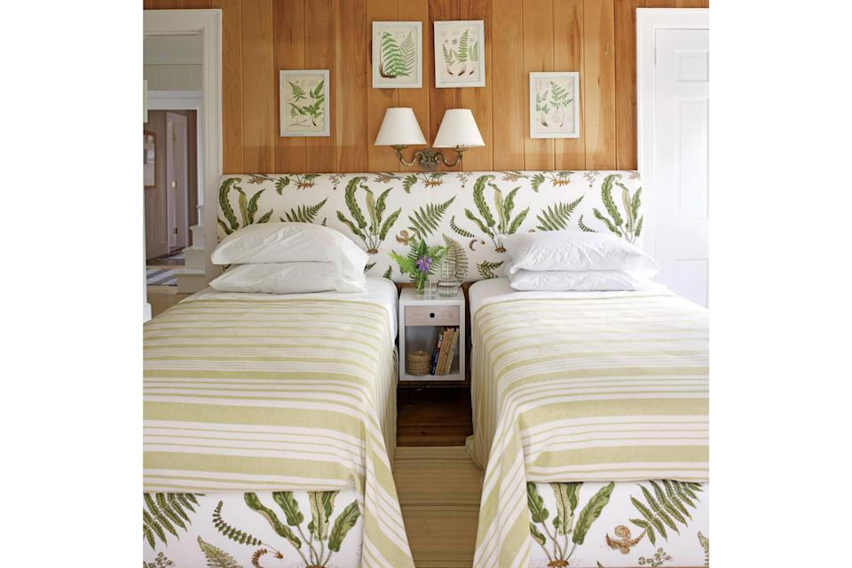 <p>Use a single bombshell headboard to create an easy, beachy switch from single beds to double. Design by Tom Scheerer.</p>