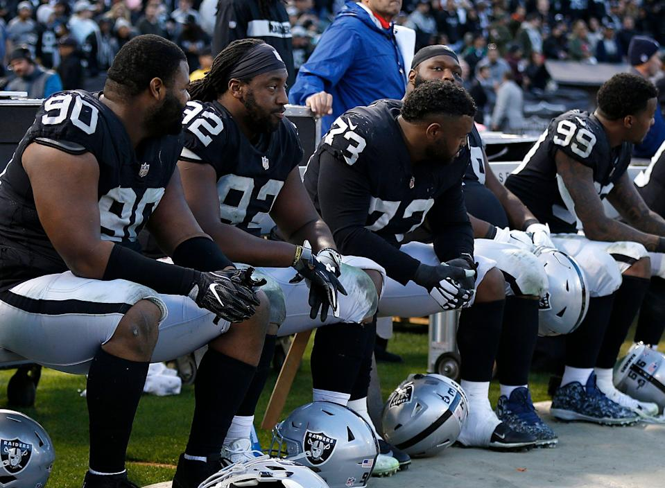 Oakland Raiders players sit on the bench during the second half of an NFL football game against the Kansas City Chiefs in Oakland, Calif., Sunday, Dec. 2, 2018. (AP Photo/D. Ross Cameron)