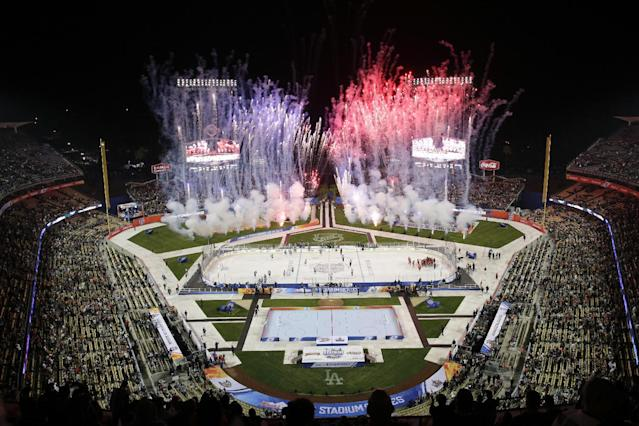 Fireworks explode after an NHL outdoor hockey game between the Los Angeles Kings and the Anaheim Ducks at Dodger Stadium on Saturday, Jan. 25, 2014, in Los Angeles. The Ducks won 3-0. (AP Photo/Jae C. Hong)