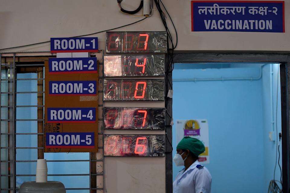 A medical worker stands in a vaccination room while waiting to inoculate colleagues with a Covid-19 coronavirus vaccine at the Rajawadi Hospital in Mumbai on January 16, 2021. (Photo by Indranil MUKHERJEE / AFP) (Photo by INDRANIL MUKHERJEE/AFP via Getty Images)