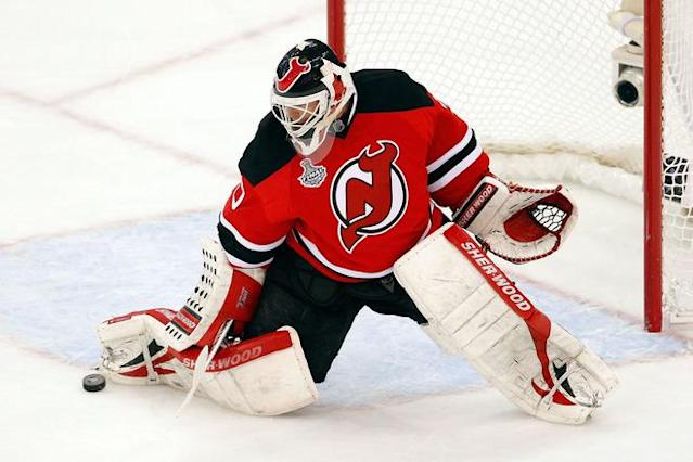 NEWARK, NJ - JUNE 09: Martin Brodeur #30 of the New Jersey Devils makes a save against the Los Angeles Kings during Game Five of the 2012 NHL Stanley Cup Final at the Prudential Center on June 9, 2012 in Newark, New Jersey. (Photo by Paul Bereswill/Getty Images)