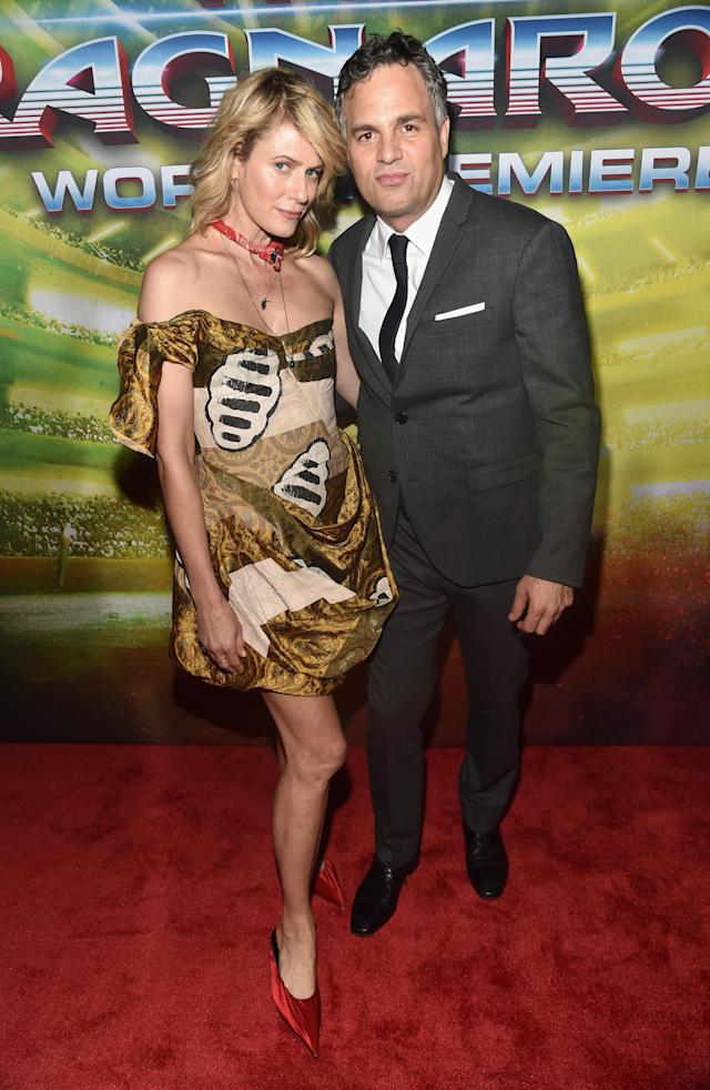 <p>One of Hollywood's favorite red carpet couples made an appearance, featuring Coigney in a short statement frock and pointy-toed red heels. (Photo: Getty Images) </p>