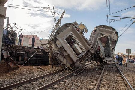Security personnel are seen at the site of a train derailment at Sidi Bouknadel near the Moroccan capital Rabat, Morocco, October 16, 2018. REUTERS/Youssef Boudlal