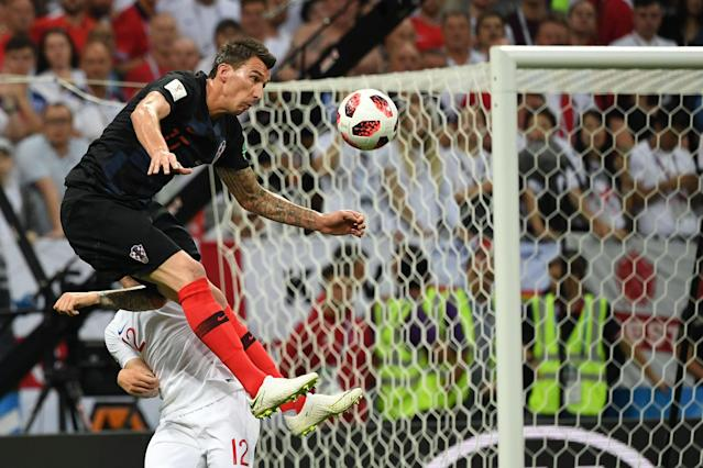 <p>Croatia's forward Mario Mandzukic (L) vies for the header with England's defender Kieran Trippier during the Russia 2018 World Cup semi-final football match between Croatia and England at the Luzhniki Stadium in Moscow on July 11, 2018. (Photo by MANAN VATSYAYANA / AFP) </p>