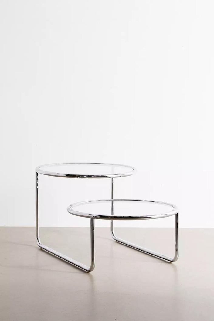 """$249, Urban Outfitters. <a href=""""https://www.urbanoutfitters.com/shop/selene-2-tier-coffee-table"""" rel=""""nofollow noopener"""" target=""""_blank"""" data-ylk=""""slk:Get it now!"""" class=""""link rapid-noclick-resp"""">Get it now!</a>"""