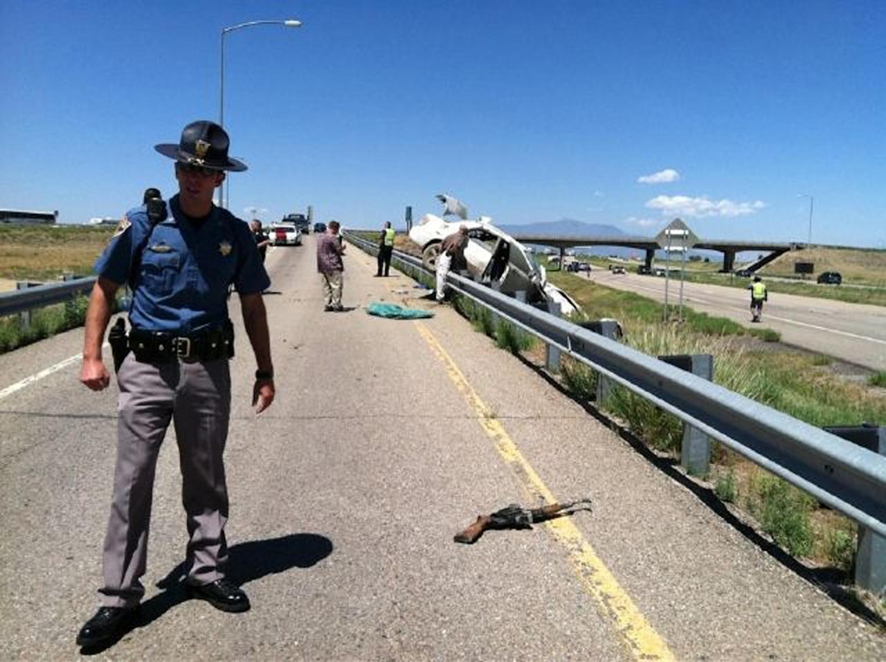 In this photo provided by the Colorado State Patrol, authorities investigate the scene where three fugitive siblings wanted in a crime spree in Florida and Georgia were captured Wednesday, Aug. 10, 2011, along Interstate 25 in Walsenburg, Colo., after firing shots at officers during a high-speed chase and crashing their car into a highway barrier, authorities said. (AP Photo/Colorado State Patrol)
