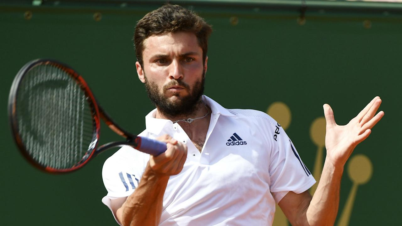There were wins for Gilles Simon and Benoit Paire at the German Tennis Championships on Monday.