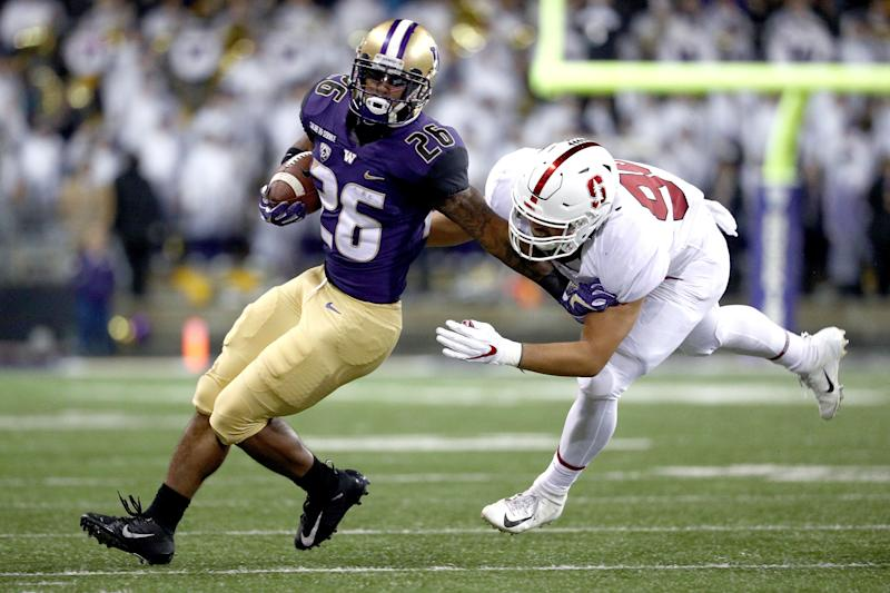 SEATTLE, WA - NOVEMBER 03: Salvon Ahmed #26 of the Washington Huskies works against Gabe Reid #90 of the Stanford Cardinal in the second quarter during their game at Husky Stadium on November 3, 2018 in Seattle, Washington. (Photo by Abbie Parr/Getty Images)