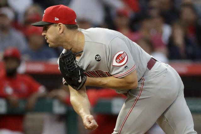 Cincinnati Reds starting pitcher Tyler Mahle throws to a Los Angeles Angels batter during the first inning of a baseball game in Anaheim, Calif., Tuesday, June 25, 2019. (AP Photo/Chris Carlson)