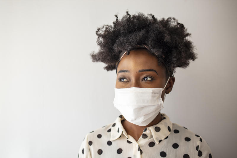 African - American woman wearing mask for protect.