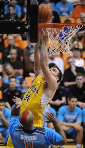 California's Robert Thurman shoots against Oregon State's Joe Burton (11) during the first half of an NCAA college basketball game in Corvallis, Ore., Saturday, Feb. 23, 2013. (AP Photo/Greg Wahl-Stephens)