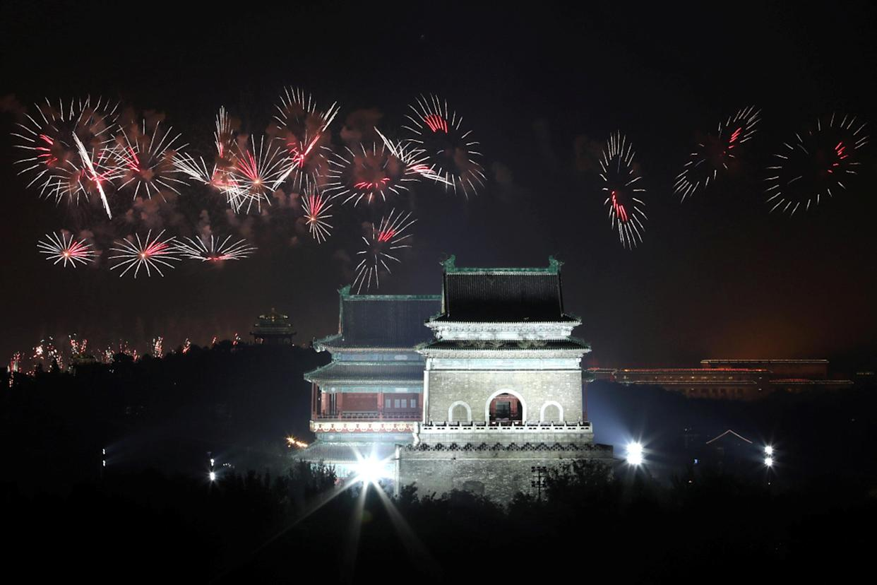 Fireworks explode over the Bell and Drum Towers during an evening gala marking the 70th anniversary of the founding of the People's Republic of China, on its National Day, in Beijing, China October 1, 2019. (Photo: Sheng Li/Reuters)