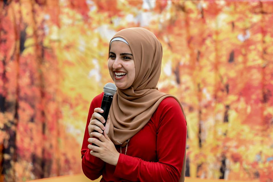 Essma Bengabsia emcees a Modesty Styles fashion show in Teaneck, N.J., on Sept. 28, 2019.