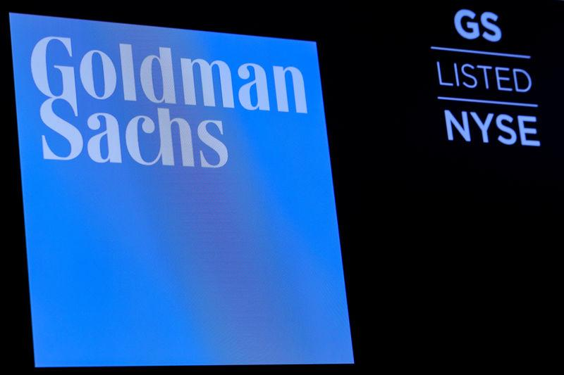 The ticker symbol and logo for Goldman Sachs is displayed on a screen on the floor at the NYSE in New York