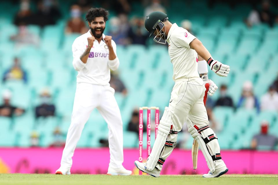Matthew Wade looks dejected after being dismissed by Ravindra Jadeja.