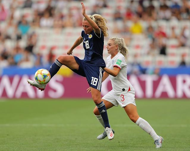 Claire Emslie of Scotland battles for possession with Alex Greenwood of England during the 2019 FIFA Women's World Cup France group D match between England and Scotland at Stade de Nice on June 09, 2019 in Nice, France. (Photo by Richard Heathcote/Getty Images)