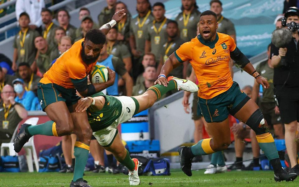 Australia's Marika Koroibete tries to avoid a tackle during the rugby Championship match against South Africa at the Suncorp Stadium in Brisbane on September 18, 2021 - AFP