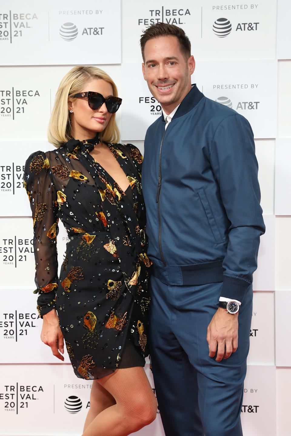 Paris Hilton (L) and Carter Reum got engaged earlier this year. (Photo by Monica Schipper/Getty Images)