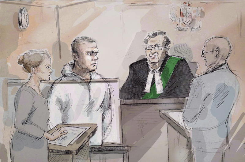 File-This April 24, 2018, file photo shows Duty counsel Georgia Koulis, left to right, Alek Minassian, Justice of the Peace Stephen Waisberg, and Crown prosecutor Joe Callaghan in court in Toronto. A newly released video shows Minassian, accused of driving a van into pedestrians in Toronto and killing 10 people, telling police he accomplished his mission and that he's part of an online group of sexually frustrated men who plot attacks against people who have sex.  (Alexandra Newbould/The Canadian Press via AP, File)