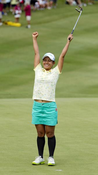 Ai Miyazato, of Japan, celebrates winning the LPGA LOTTE Championship golf tournament at Ko Olina Golf Club Saturday, April 21, 2012, in Kapolei, Hawaii. (AP Photo/Eugene Tanner)