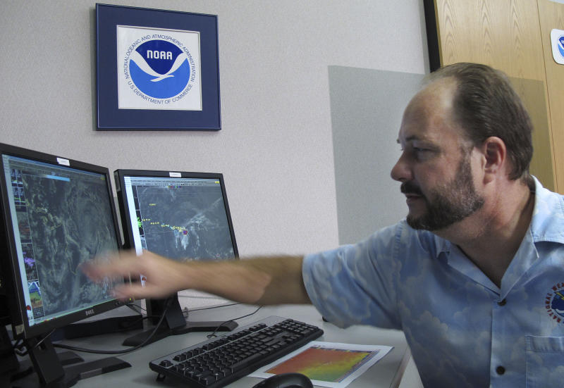 Tom Evans, acting director of the Central Pacific Hurricane Center, shows satellite images of Hurricane Flossie in Honolulu on Monday, July 29, 2013. A tropical storm making its way toward Hawaii had residents of Maui and the Big Island on Monday bracing for possible flooding, 60 mph wind gusts and waves that could reach as high as 18 feet. Tropical Storm Flossie could also bring mudslides, tornadoes and waterspouts, forecasters said. (AP Photo/Oskar Garcia)
